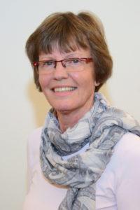 Frau mit brille und grauem schal